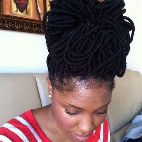procedure of petals hairstyle yarn wraps styles into a loc petal bun bun yarnwraps