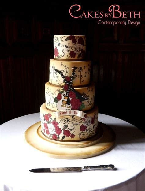 cake tattoo rocks guitar and themed wedding cake