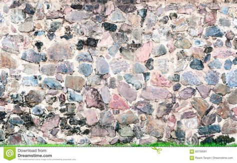 pattern of stone wall surface with cement royalty free