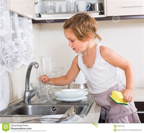 Washing Baby In Kitchen Sink Baby In Kitchen Sink Dishes Pots And Pans In Sink Cups