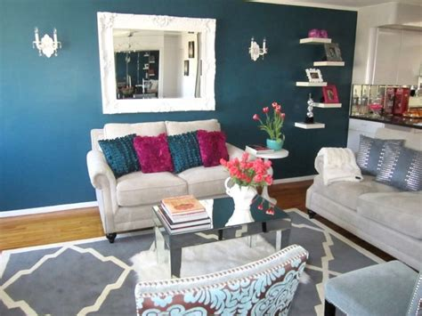turquoise rug living room living rooms sofa mirror throw pillows coffee table shelves gray fuschia turquoise