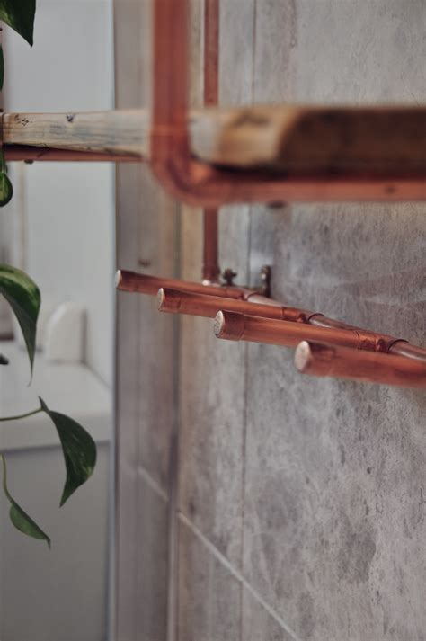 copper pipe reclaimed wood shelving with coat hooks copper pipe reclaimed wood shelving with coat hooks