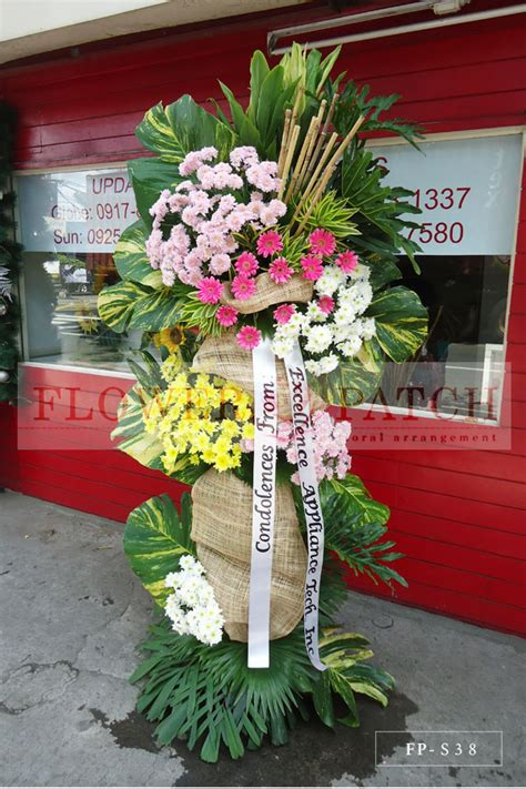 funeral colors standing arrangement of gerberas and assorted colors of