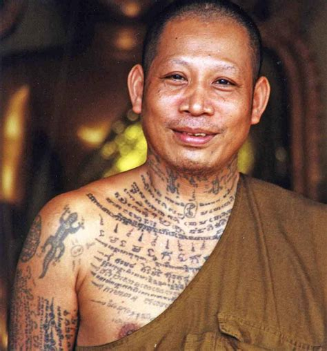 tattooed monk asiaphotostock tatooed thai monk