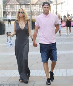 sarah harding takes the plunge in a revealing maxi as she enjoys a romantic stroll with