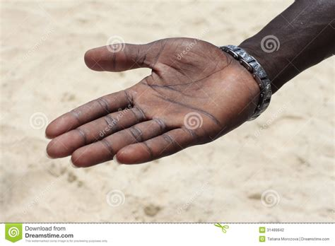 black hand open hand stock photo image of sign sand gripping