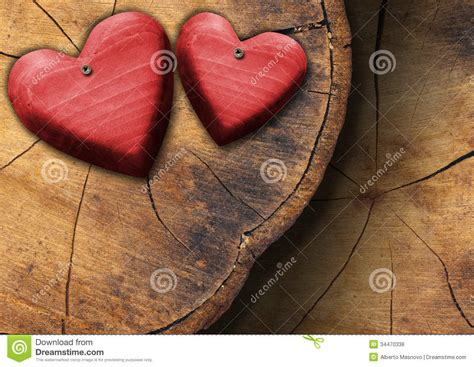 Handcrafted Hearts - wooden hearts on trunk section stock photo image of
