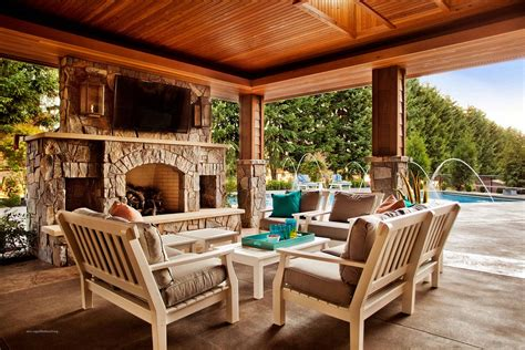 covered patio designs with fireplace include decorations