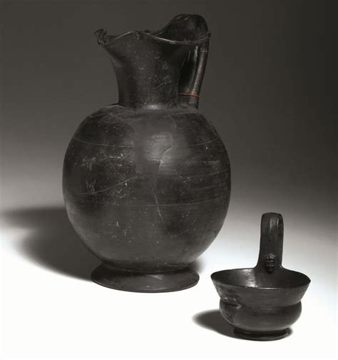 vasi di bucchero oinochoe e kyathos in bucchero antiquities auction