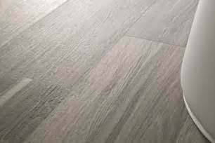 wonderful Cost Of Tile That Looks Like Wood #3: outstanding-ceramic-tile-wood-look-with-cross-section-wood-tile-next-to-floor-tile.jpg
