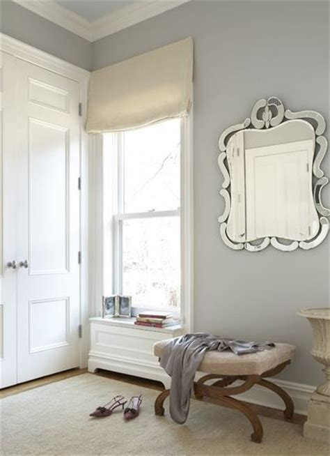 closets blue gray walls mirror ottoman oatmeal linen shade gray dressing room design