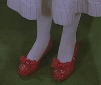 return to oz ruby slippers cowardly gif find on giphy