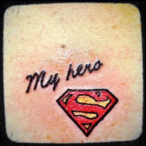 small superman tattoo i like this cause my has the superman logo tattooed on