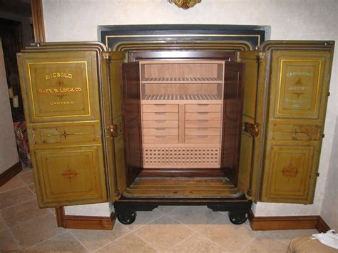 expert woodworking an antique safe converted to a cigar humidor stained