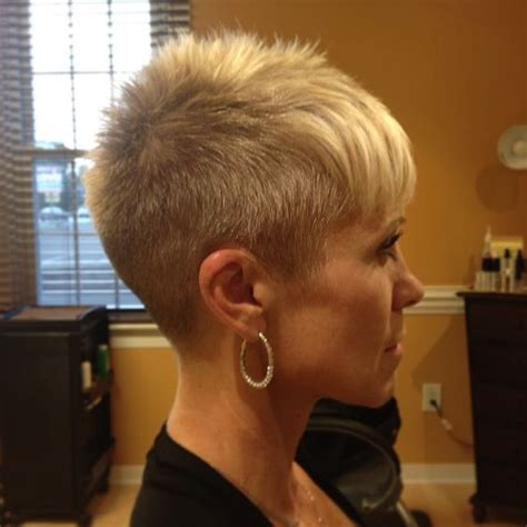 woman cuts hair with fork and clippers blonde pixie clipper cut short haircuts pinterest