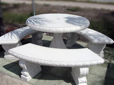 white outdoor benches  concrete table  benches