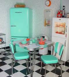 black and white diamond printed floor with teak fridge and
