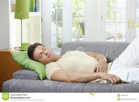 man sleeping on couch man sleeping on sofa stock photo image of cushion joyous