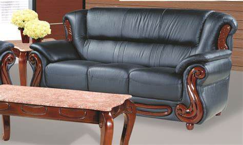 black traditional leather sofa with cherry accents