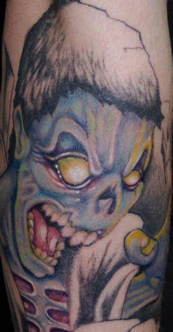 zombie tattoo on the hand tattooimages biz angry blue zombie tattoo tattooimages biz