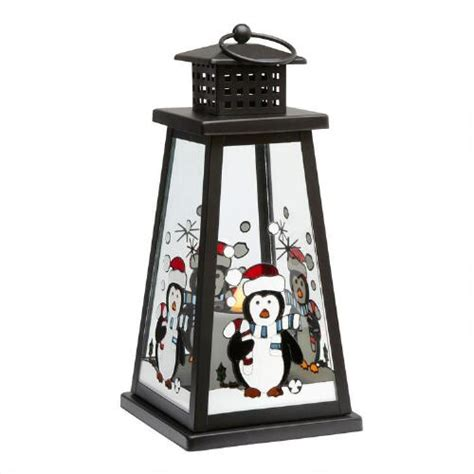 black solar lantern with chilly penguin christmas tree