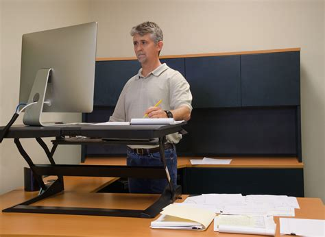stand and deliver advantages of standing desks