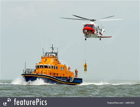 boat pictures helicopter orange sea rescue boat with rescue helicopter stock