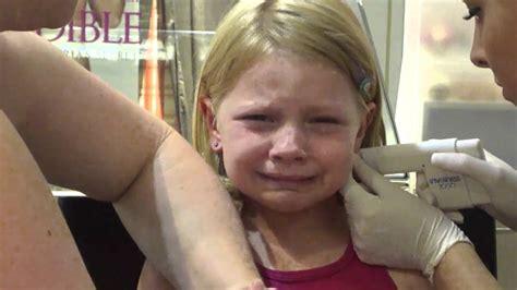 just got ears pierced when do i remove the studs ella gets her ears pierced youtube