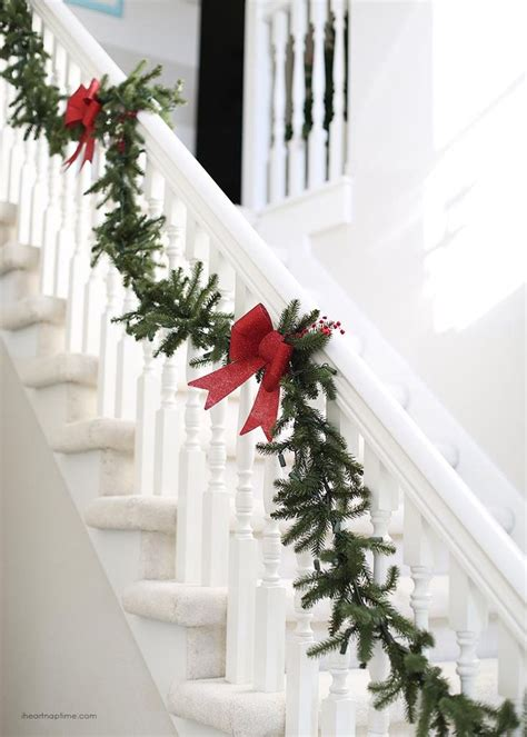 christmas banister garland best 25 christmas garland for stairs ideas on pinterest