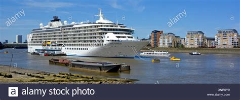 thames river shipyard the world floating hotel and cruise ship moored on the