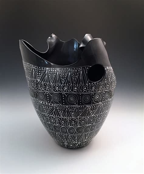 black and white pattern vase black and white sculpted tall vase with intricate pattern