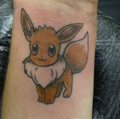 eevee tattoo 30 phenomenal wrist tattoos you don t want to miss