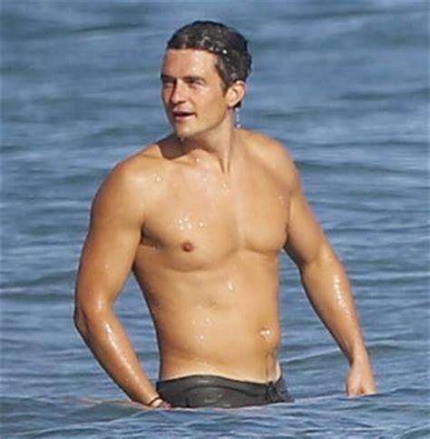 Buff Martin Garrix orlando bloom is shirtless as he hits the in malibu