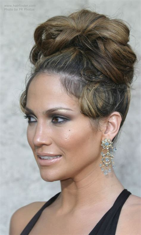 updo hairstyles jlo jennifer lopez with her hair in a high updo with curls