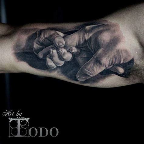baby hand tattoos baby holding s finger realistic on bicep by todo
