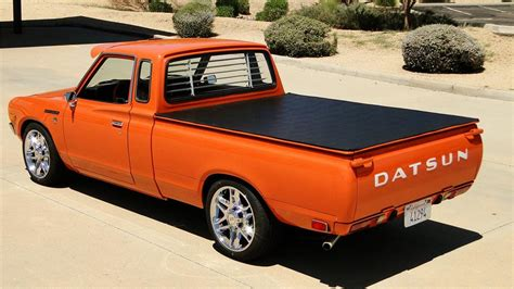 Orange Front Door by 1978 Datsun 620 Custom King Cab Pickup 177077
