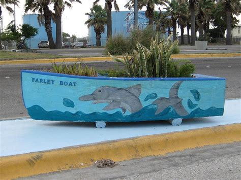 farley boat planter farley planter boat photograph by wendell baggett