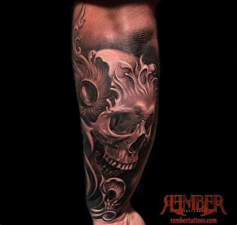 black tattoo artist black and grey realistic skull by rember age