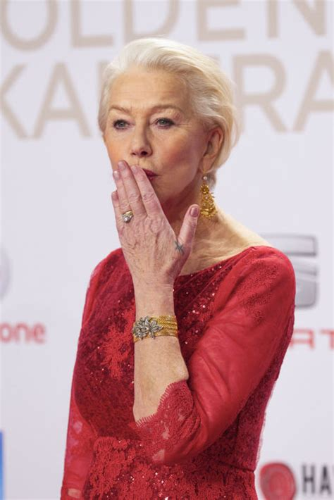 tattoo on helen mirren s hand judi dench gets her first tattoo at 81 years old photos
