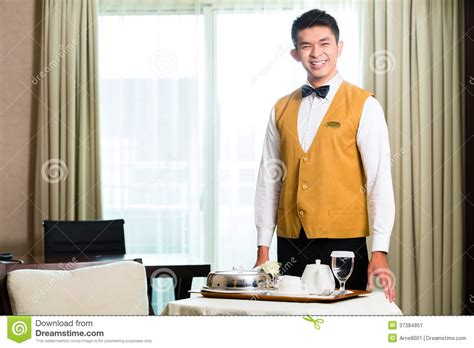 asian room service waiter serving food in hotel stock image image 37384851
