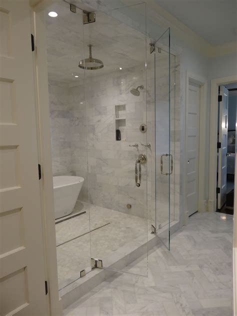 bath in room steam shower with marble tiling swing in and out doors