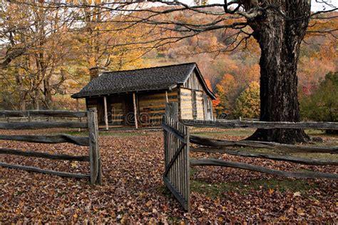 autumn log cabin  rail fence stock image image