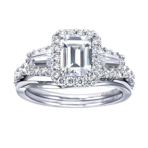 halo emerald cut and baguette engagement ring