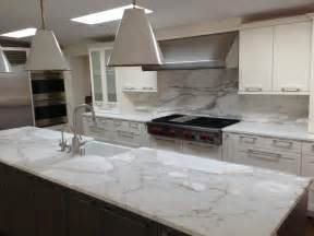 pictures of kitchen countertops and backsplashes a remodeled kitchen with a slab of granite island matching