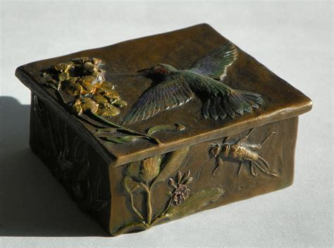hummingbird box with painted patina stonefly side