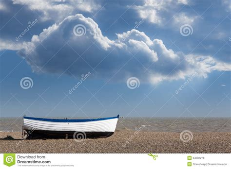 pebble art fishing boat old fishing boat on pebble beach royalty free stock photos