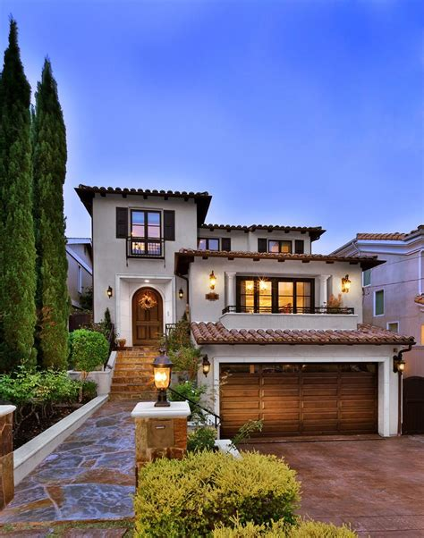 luxury spanish villa style home exterior digs cover