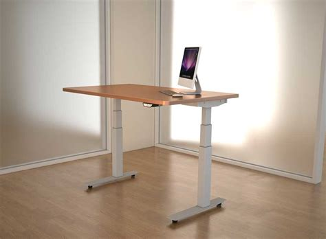 Adjustable Height Desks Break The Monotony At The Office Desk Height Adjusters