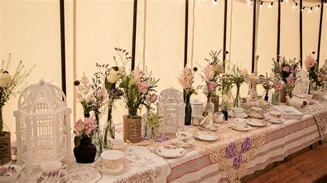 create an country garden wedding with birdcage lanterns and vintage crockery hanging