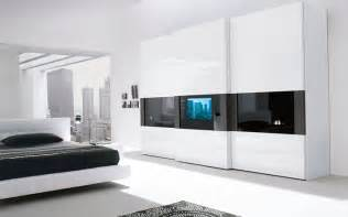 modern bedroom wardrobe with a tv built in the door